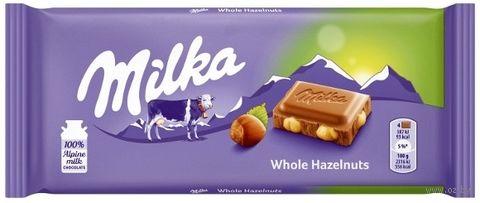 """Шоколад молочный """"Milka. C цельным фундуком"""" (100 г) — фото, картинка"""